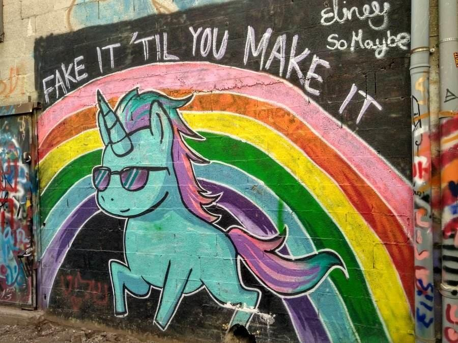 Israel: Tel Avivs Florenin neighborhood street art - unicorn graffiti. Fake it till you make it.